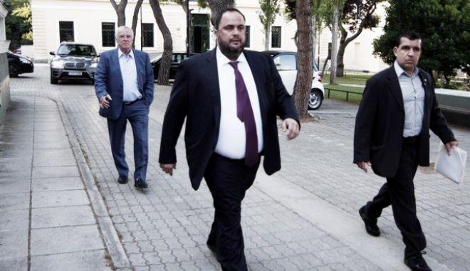 Ο πρόεδρος της Ολυμπιακού Γιώργος Μαρινάκης, στο  γραφείο του ειδικού ανακριτή σε θέματα διαφθοράς, Γιώργου Ανδρεάδη στα δικαστήρια της οδού Ευελπίδων την Πέμπτη 18 Ιουνίου 2015, για να απολογηθεί για τις κατηγορίες του στην υπόθεση της ύπαρξης εγκληματικής οργάνωσης στο ελληνικό ποδόσφαιρο.(EUROKINISSI-ΣΤΕΛΙΟΣ ΣΤΕΦΑΝΟΥ)