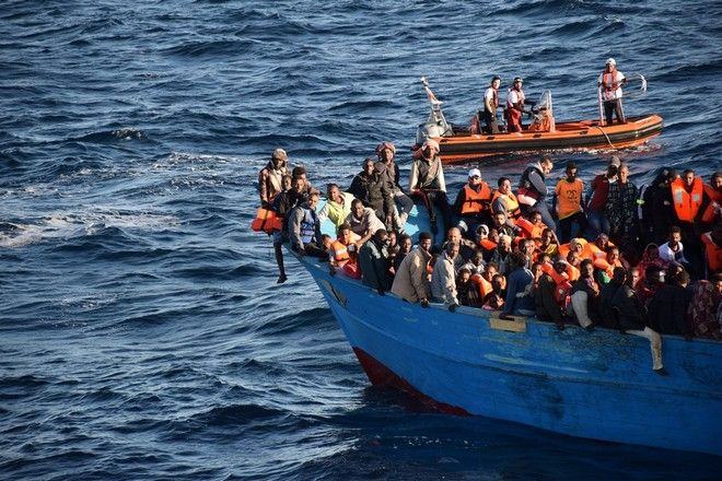 Bourbon Argos and Aquarius crew and Medecins Sans Frontieres (MSF) staff rescue 700 people aboard an overcrowded wooden boat in the Central Mediterranean Sea.