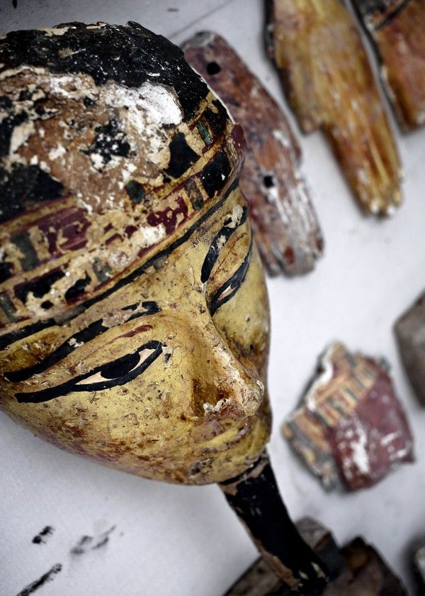 Wood parts from coffins on display at the entrance of the New Kingdom tomb that belongs to a royal goldsmith in a burial shaft during a press conference on site, in Luxor, Egypt, Saturday, Sept. 9, 2017. El-Anany said the tomb is not in good condition, but it contains a statue of the goldsmith and his wife as well as a funerary mask. He said a shaft in the tomb contained mummies belonging to ancient Egyptian people who lived during the 21st and 22nd dynasties. (AP Photo/Nariman El-Mofty)