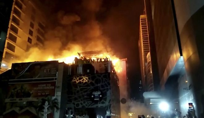 In this image made from video, a building is on fire in Mumbai, India, early Friday, Dec. 29, 2017. A number of people were killed and many more injured in a fire that broke out in a restaurant in Mumbai, India's financial and entertainment capital, early Friday, officials said. (Anand Shrivastav via AP)