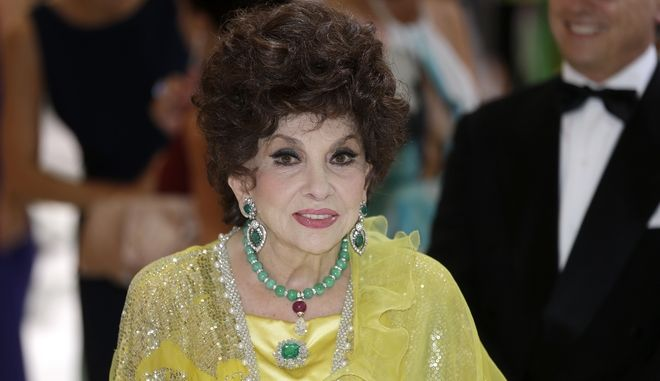 "Italian actress Gina Lollobrigida arrives at the ""Monaco Red Cross Ball"", Friday, Aug. 1, 2014, in Monaco. The Monaco Red Cross Ball is a charity gala evening brings together high society as well as donors from all over the world. (AP Photo/Lionel Cironneau)"