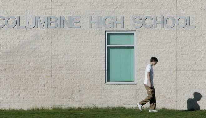 A student arrives for classes at Columbine High School in Littleton, Colo., on Wednesday, April 19, 2006, the eve of the anniversary of the massacre at the school.  Thursday is the 7th anniversary of the shooting where 12 students and teacher Dave Sanders were killed by suicidal teens Eric Harris and Dylan Klebold. (AP Photo/Ed Andrieski)