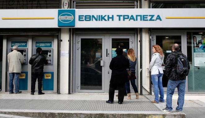 Customers use automated teller machines (ATM) operated by the National Bank of Greece SA in Thessaloniki, Greece, on Monday, May 11, 2015.