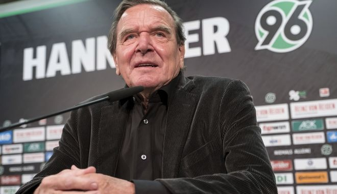 The new chairman of the supervisory board of Hannover 96, former German chancellor  Gerhard Schroeder, speaks during a press conference of the German second division club of  Hannover 96 in Hannover, Germany, Monday Jan. 23, 2017. (Peter Steffen/dpa via AP)