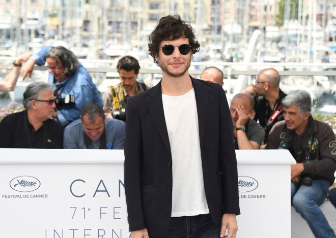 Director Luis Ortega poses for photographers during a photo call for the film 'El Angel' at the 71st international film festival, Cannes, southern France, Friday, May 11, 2018. (Photo by Arthur Mola/Invision/AP)