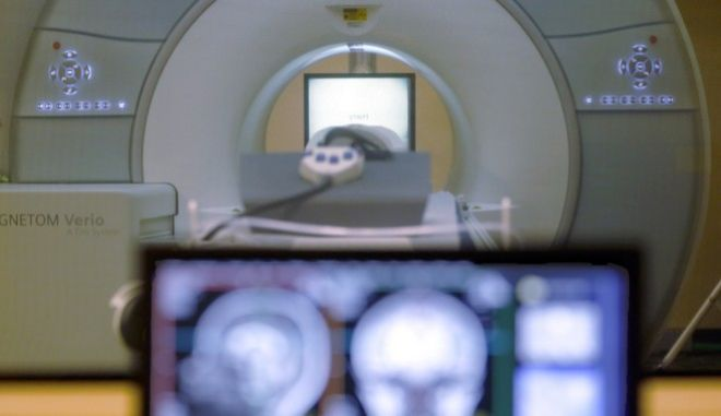 FILE - In this Nov. 26, 2014 file photo, a brain-scanning MRI machine at Carnegie Mellon University in Pittsburgh. In a study coming out in the tail end of a U.S. presidential election where the truth has been strained, neuroscientists at the University College Londons Affective Brain Lab put 80 people in scenarios where they could repeatedly lie and get paid more based on the magnitude of their lies. They said they were the first to demonstrate empirically that peoples lies grow bolder the more they fib. (AP Photo/Keith Srakocic, File)