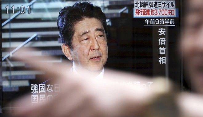 A man walks past a public TV screen showing Japanese Prime Minister Shinzo Abe speak on North Korea's launch of missile, in Tokyo, Friday, Sept. 15, 2017. North Korea fired an intermediate-range missile over Japan into the northern Pacific Ocean on Friday, U.S. and South Korean militaries said, its longest-ever such flight and a clear message of defiance to its rivals. (AP Photo/Eugene Hoshiko)