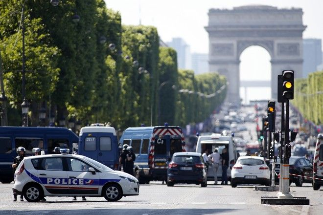 Police forces secure the area on the Champs Elysées in Paris, Monday, June 19, 2017. A driver rammed his car into a police vehicle in the Champs-Elysees shopping district Monday, prompting a fiery explosion, and was likely killed in the incident, authorities said. France's anti-terrorism prosecutor opened an investigation. (AP Photo/Matthieu Alexandre)