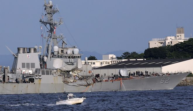 The damaged USS Fitzgerald is seen near the U.S. Naval base in Yokosuka, southwest of Tokyo, after the U.S. destroyer collided with the Philippine-registered container ship ACX Crystal in the waters off the Izu Peninsula Saturday, June 17, 2017. The USS Fitzgerald was back at its home port in Japan after colliding before dawn Saturday with a container ship four times its size, while the coast guard and Japanese and U.S. military searched for seven sailors missing after the crash. (AP Photo/Eugene Hoshiko)
