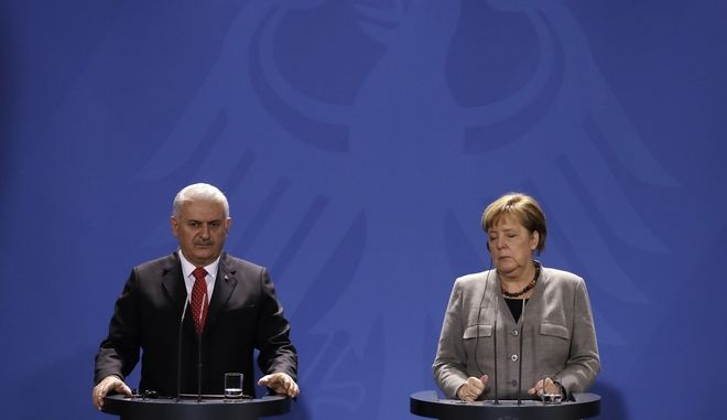 German Chancellor Angela Merkel, right, closes her eyes when listening to Turkish Prime Minister Binali Yildirim during a press conference after a meeting in the chancellery in Berlin, Germany, Thursday, Feb. 15, 2018. (AP Photo/Markus Schreiber)