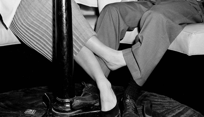 A couple play footsie under the table at the Copacabana night club in New York, Jan. 25, 1952.  (AP Photo/Ed Ford)