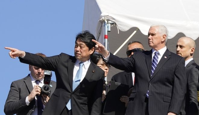 U.S. Vice President Mike Pence, second from right, and Japanese Defense Minister Itsunori Onodera, left, look toward a PAC-3 interceptor missile system deployed at Defense Ministry in Tokyo Wednesday, Feb. 7, 2018. Pence, who arrived Tuesday in Japan, said he has not ruled out the possibility of meeting with North Korean officials at the upcoming Olympics in South Korea. (AP Photo/Shizuo Kambayashi, Pool)
