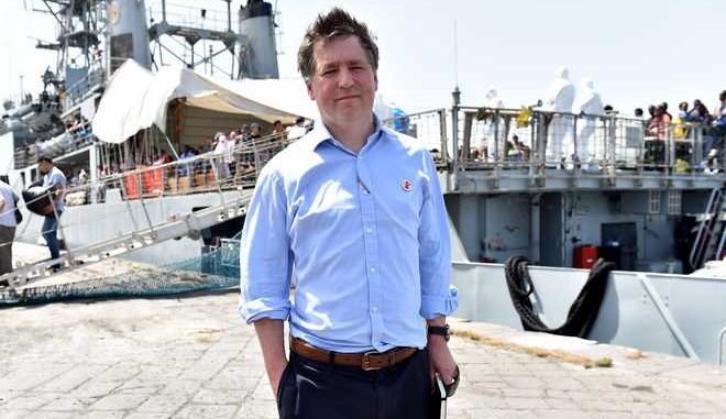 Justin Forsyth, chief executive of Save the Children poses for a photo as migrants disembark from the Irish Navy ship P31 L.E. Eithne at the Catania harbor, Italy, Tuesday, June 16, 2015. European Union nations failed to bridge differences Tuesday over an emergency plan to share the burden of the thousands of refugees crossing the Mediterranean, while on the French-Italian border, police in riot gear forcibly removed dozens of migrants. (AP Photo/Carmelo Imbesi)