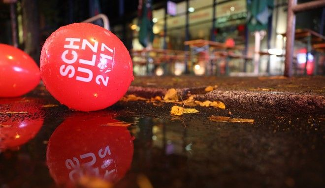 """A balloon that reads """"Schulz 2017"""" sits on the floor in a puddle at an SPD's election party in Berlin, Germany, Sunday, Sept. 24, 2017. (Kay Nietfeld/dpa via AP)"""