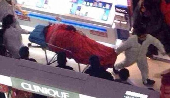 """Enraged Chinese boyfriend Tao Hsiao, 38, jumped to his death after a furious row with his girlfriend, 23, after she insisted on going into yet another clothes shop.  According to CCTV images the pair had already been at the shopping mall in the city of Xuzhou in Jiangsu province in the east of China for five hours when Tao had said he had finally had enough, and demanded to go home.  He complained that they already had more bags than he and his girlfriend could carry, but she insisted on going into one more shop where the was a special offer on shoes.  An eyewitness said: """"He told her she already had enough shoes, more shoes that she could wear in a lifetime, and it was pointless buying any more. She started shouting at him accusing him of being a skinflint and of spoiling Christmas, it was a really heated argument.""""  The shouting match ended when the man chucked the bags on the floor and jumped over the balcony, smashing into Christmas decorations on his way down before hitting the floor seven stories below causing shocked shoppers to flee in panic.  Emergency services were quickly on the scene but was too late to rescue the man who was killed instantly.  A shopping spokesman said: """"His body was removed fairly quickly. He actually landed on one of the stalls below and then fell to the floor so although the store was damaged it meant he didn't hit anybody. This is a tragic incident, but this time of year can be very stressful for many people."""""""