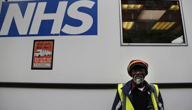 "In this Wednesday, Oct. 16, 2013 photo, volunteer Horace Reid, 58, waits outside an X-ray van, parked outside a homeless shelter, in London. In 2009, Reid got tested on the van after he and several friends ran to catch a bus. To convince homeless people to get tested, the van now relies on former TB patients including Reid. ""I didnt know anything was wrong until I missed the bus and couldnt breathe, he said. (The doctors) told me I had TB and that I could die,"" he said. Reid, 58, eventually recovered and now tries to convince skeptics to get an X-ray. Last year, London had about 3,500 TB cases - more than the Netherlands, Belgium, Greece and Norway combined. In response, health officials are taking to the streets in an effort to stop the spread of the infectious lung disease, with a high-tech white van equipped with an X-ray machine that drives around London offering free check-ups. Londons 460,000 British pounds (some $743,329) TB van has an X-ray machine whose scans can be instantly read by a radiographer. The entire process of getting an X-ray and its results takes about 90 seconds. (AP Photo/Lefteris Pitarakis)"