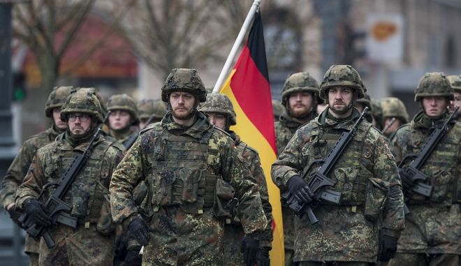 Members of the German Army attend a military parade ceremony marking the 99th anniversary of the Lithuanian military on Armed Forces Day at the Gedimino ave in Vilnius, Lithuania, Thursday, Nov. 24, 2017.  For Lithuanians, the holiday honours the restoration of the country's armed forces in 1918 after the end of WWI. (AP Photo/Mindaugas Kulbis)