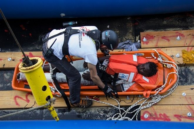A man rescued by stretcher from a  boat by Medecins Sans Frontieres (MSF) and the Bourbon Argos in the Central Mediterranean.