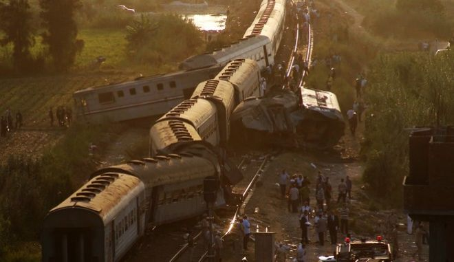 Cars from two passenger trains lie off the tracks after they collided just outside Egypt's Mediterranean port city of Alexandria, Friday, Aug. 11, 2017. Authorities said it was the country's deadliest rail accident in more than a decade. (AP Photo/Ravy Shaker)