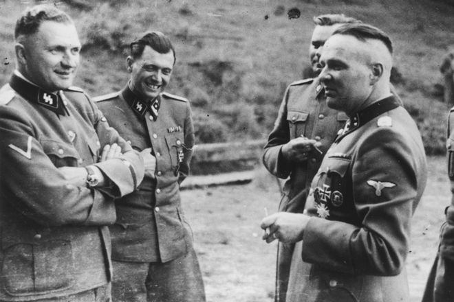This 1944 photo provided by the U.S. Holocaust Memorial Museum (USHMM) shows SS officers socializing in their retreat at Solahutte outside of Auschwitz, Poland. From left Richard Baer, who became the commandant of Auschwitz in May 1944, Dr. Josef Mengele, Commandant of Birkenau Josef Kramer, hidden, and the former Commandant of Auschwitz Rudolf Hoess, foreground; the man at right is unidentified. The photo is one of approximately 116 rare photographs of senior SS officers and Nazi officials at the Auschwitz concentration camp unveiled Wednesday, Sept. 19, 2007, by the museum. (AP Photo/USHMM) ** ONE TIME USE ONLY. NO SALES. NO ARCHIVES **