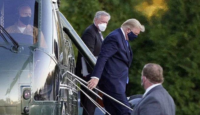 President Donald Trump arrives at Walter Reed National Military Medical Center, in Bethesda, Md., Friday, Oct. 2, 2020, on Marine One after he tested positive for COVID-19. (AP Photo/Jacquelyn Martin)