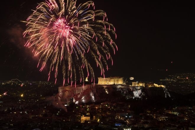 Fireworks explode over the temple of Parthenon at the top of Acropolis hill during the New Year celebrations in Athens, Greece on January 01, 2017. /               01  2017.
