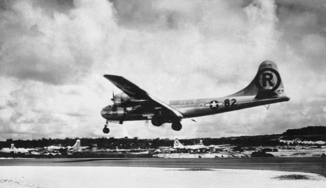 "FILE - In this Aug. 6, 1945 file photo, the ""Enola Gay"" Boeing B-29 Superfortress lands at Tinian, Northern Mariana Islands after the U.S. atomic bombing mission against the Japanese city of Hiroshima. Max Desfor, a former Associated Press photographer who won a Pulitzer Prize for his coverage of the Korean War died Monday, Feb. 19, 2018. He was 104. Desfor photographed the crew of the Enola Gay after the B-29 dropped an atomic bomb on Hiroshima in August 1945.  (AP Photo/Max Desfor, File)"