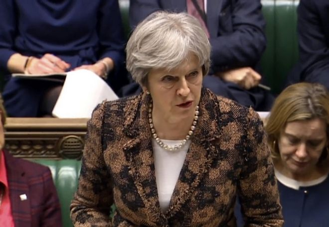 Britain's Prime Minister Theresa May speaks in the House of Commons in London, Monday, March 12, 2018. British Prime Minister Theresa May says her government has concluded it is