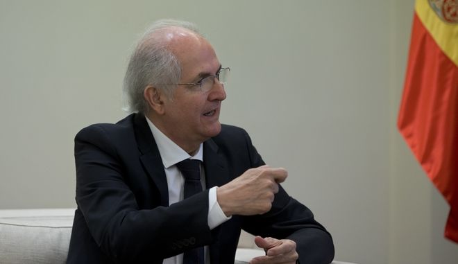 Former Caracas Mayor Antonio Ledezma speaks during a meeting with Spain's Prime Minister Mariano Rajoy at the Moncloa Palace in Madrid, Spain, Saturday, Nov. 18, 2017. The ousted mayor of Caracas pledged to spread his protest against Venezuela's socialist government across the world as he arrived in Spain on Saturday, a day after escaping from house arrest and slipping past security forces into Colombia. (AP Photo/Paul White)