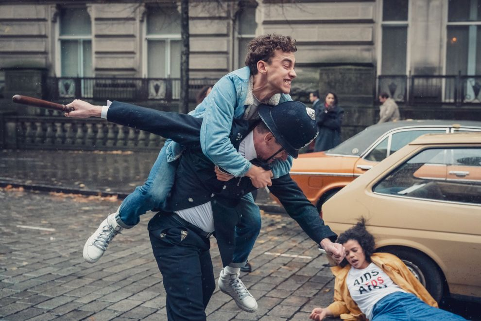 Richie (Olly Alexander) ontop of policeman. Person on the floor - Jill (Lydia)