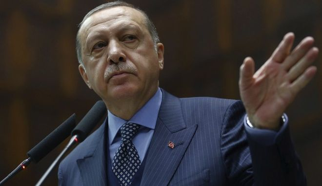"""Turkey's President Recep Tayyip Erdogan addresses his supporters at the parliament in Ankara, Turkey, Tuesday, Nov. 28. 2017. Erdogan says a telephone conversation he held with U.S. President Donald Trump last week was the first time in a long while since Turkish and U.S. leaders were on the same """"wavelength."""" (Pool Photo via AP )"""