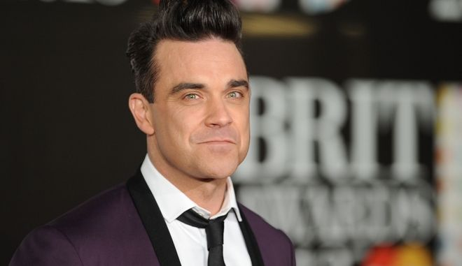 Robbie Williams seen arriving at the BRIT Awards 2013 at the o2 Arena on Wednesday, Feb. 20, 2013, in London. (Photo by Jon Furniss Photography/Invision/AP)