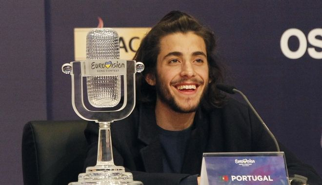 "Salvador Sobral from Portugal smiles as he speaks after winning the Final of the Eurovision Song Contest with his song ""Amar pelos dois"" during a press conference in Kiev, Ukraine, Saturday, May 13, 2017. (AP Photo/Sergei Chuzavkov)"