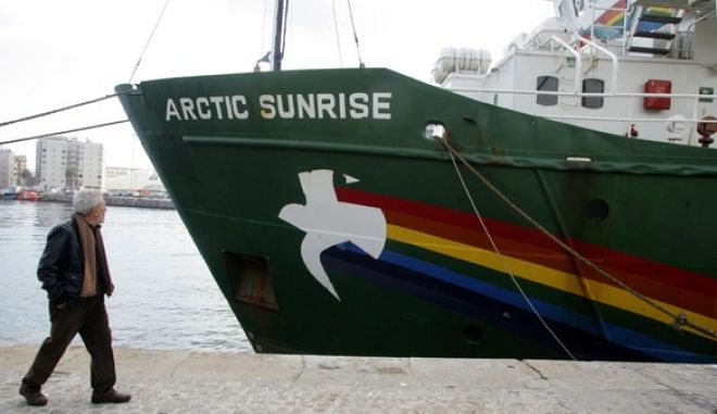 A man walks past Greenpeace ship Arctic Sunrise which is docked at Barcelona's harbour, February 11, 2008. Director of Greenpeace in Spain, Jose Luis Garcia Lorenzo, held a news conference on Spanish areas of pollution in Barcelona today. REUTERS/Gustau Nacarino  (SPAIN) - RTR1WYS5