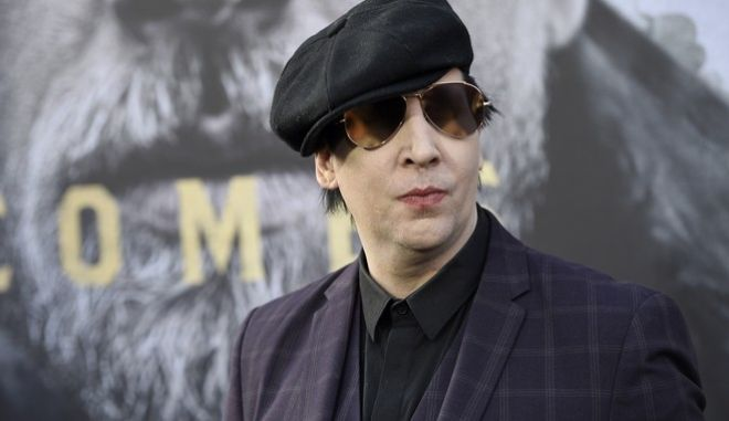 """Marilyn Manson arrives at the world premiere of """"King Arthur: Legend of the Sword"""" at the TCL Chinese Theatre on Monday, May 8, 2017, in Los Angeles. (Photo by Chris Pizzello/Invision/AP)"""