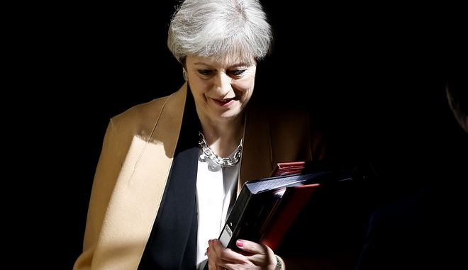 British Prime Minister Theresa May leaves 10 Downing Street in London, to attend Prime Minister's Questions at the Houses of Parliament, Wednesday, April 19, 2017. (AP Photo/Frank Augstein)
