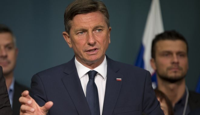 Slovenia's President Borut Pahor talk to the media in Ljubljana, Slovenia, Sunday, Oct. 22, 2017. Pahor, a former model and veteran politician known for his use of social media, won the most votes in a presidential election Sunday, but will face a runoff against an ambitious challenger. (AP Photo/Darko Bandic)