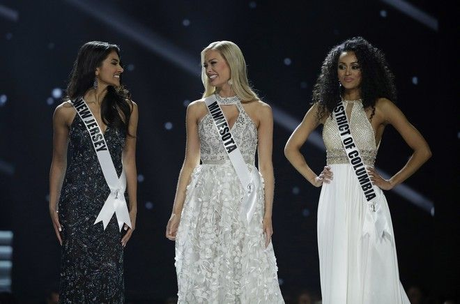 From left Miss New Jersey USA Chhavi Verg, Miss Minnesota USA Meridith Gould and Miss District of Columbia USA Kara McCullough compete during the Miss USA contest Sunday, May 14, 2017, in Las Vegas. (AP Photo/John Locher)