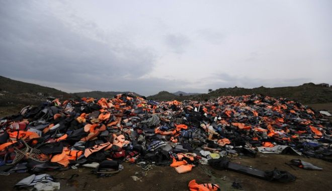 In this photo taken on Thursday, March 16, 2017 piles of life jackets used by refugees and migrants lie at a dump in Molyvos village, on the northeastern Greek island of Lesbos. The waters off northern Lesbos once resounded to the shrieks of the drowning, the whine of outboard motors as refugees struggled to reach Europe alive, and the thudding of rescue helicopter engines. A million people crossed the straits between Turkey and Greeces eastern Aegean islands in the year before March 20, 2016, and hundreds drowned. About half of those who made it landed on this island. (AP Photo/Thanassis Stavrakis)