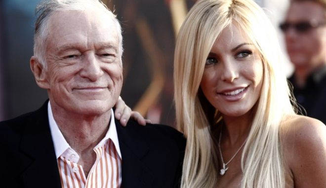 "Hugh Hefner, left, and Crystal Harris arrives at the premiere of ""Iron Man 2"" at the El Capitan Theatre in Los Angeles on Monday, April 26, 2010.  (AP Photo/Matt Sayles)"