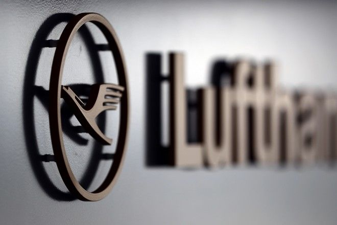 The logo of German Lufthansa airline is attached at a gate during the company's annual press conference in Munich, Germany, Thursday, March 16, 2017. (AP Photo/Matthias Schrader)