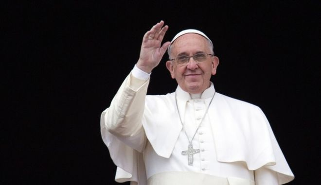 """Pope Francis waves from the central balcony of St. Peter's Basilica at the Vatican, Thursday, Dec. 25, 2014. Tens of thousands of Romans and tourists in St. Peter's Square listened as the pontiff delivered the Catholic church's traditional """"Urbi et Orbi"""" (Latin for """"to the city and to the world) Christmas message from the central balcony of St. Peter's Basilica. Francis said: """"truly there are so many tears this Christmas."""" (AP Photo/Alessandra Tarantino)"""