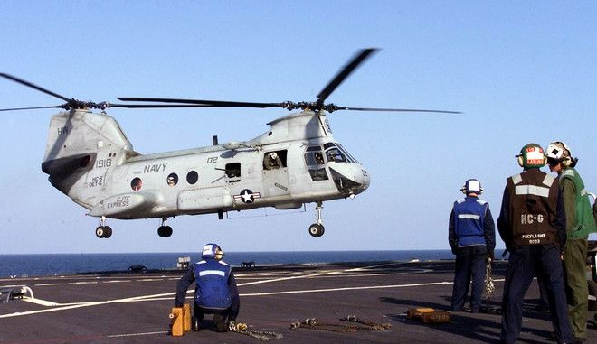 """**  FILE  ** A US Military CH-46 """"Frog"""" helicopter lands on the deck of the USS Mount Whitney, the command and control centre for a U.S.-led task force for the Horn of Africa as the ship circles in the Gulf of Aden in this Tuesday, Dec. 17, 2002 file photo. The U.S. military task force in the Horn of Africa was set up in 2002 to intercept al-Qaida suspects trying to escape from Afghanistan to Africa, but has found greater success in helping regional militaries and local people take care of themselves. The Combined Joint Task Force-Horn of Africa is based in Djibouti, a country the size of Massachusetts located on the Bab el Mandab strait where the Red Sea opens into the Indian Ocean. The country was a French colony, carved out of the Horn of Africa because of its strategic location and a natural, deep water harbor.(AP Photo/Karel Prinsloo)"""