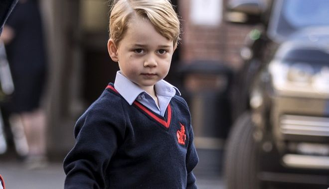 Britain's Prince George arrives for his first day of school at Thomas's school in Battersea, London, Thursday, Sept. 7, 2017.  Prince William's pregnant wife Kate was too ill with morning sickness Thursday to take young Prince George to his first day of school.  (Richard Pohle/Pool Photo via AP)