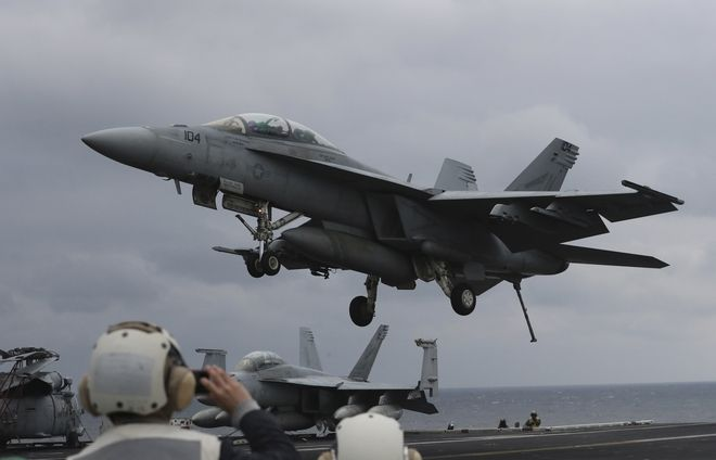 FILE - In this March 14, 2017 file photo, a U.S. Navy's F/A-18 Super Hornet fighter approaches the deck of the Nimitz-class aircraft carrier USS Carl Vinson during the annual joint military exercise called Foal Eagle between South Korea and the United States at an unidentified location in the international waters, east of the Korean Peninsula. North Korea fired a ballistic missile into the waters off its east coast on Wednesday, April 5, South Korean officials said, in a continuation of its weapons launches made as the country is angrily reacting to annual military drills between U.S. and South Korean troops. (AP Photo/Lee Jin-man, File)