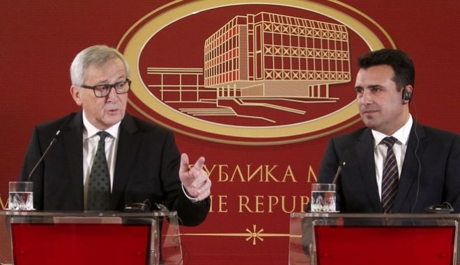 European Commission President Jean-Claude Juncker, left, talks to the media during a news conference with Macedonian Prime Minister Zoran Zaev, right, following their meeting in Skopje, Macedonia, Sunday, Feb. 25, 2018. Starting with Macedonia, Juncker is embarking on a seven-nation Balkans tour Sunday to promote the EU's new eastward expansion strategy. (AP Photo/Boris Grdanoski)