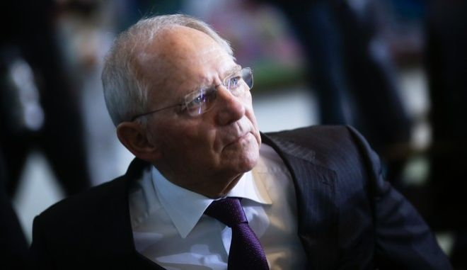 German Finance Minister Wolfgang Schaeuble arrives for the weekly cabinet meeting of the German government at the chancellery in Berlin, Wednesday, Dec. 14, 2016. (AP Photo/Markus Schreiber)