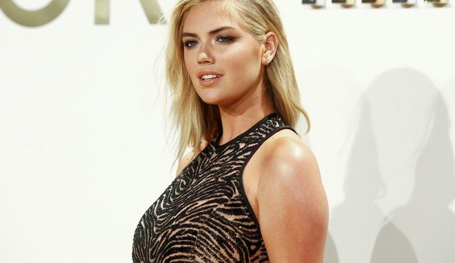 Kate Upton attends the New York Fashion Week Spring/Summer 2016 Michael Kors Gold Collection Fragrance Launch at The Top of the Standard on Sunday, Sept. 13, 2015, in New York. (Photo by Andy Kropa/Invision/AP)
