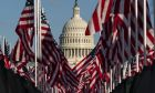 Flags are placed on the National Mall, with the U.S. Capitol behind them, ahead of the inauguration of President-elect Joe Biden and Vice President-elect Kamala Harris, Monday, Jan. 18, 2021, in Washington. (AP Photo/Alex Brandon)