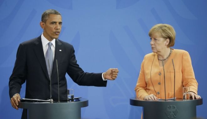 US President Barack Obama and German Chancellor Angela Merkel during their joint news conference at the Chancellery in Berlin, Germany, Wednesday, June 19, 2013. Obama will renew his call to reduce the world's nuclear stockpiles, including a proposed one-third reduction in U.S. and Russian arsenals, a senior administration official said. (AP Photo/Pablo Martinez Monsivais)